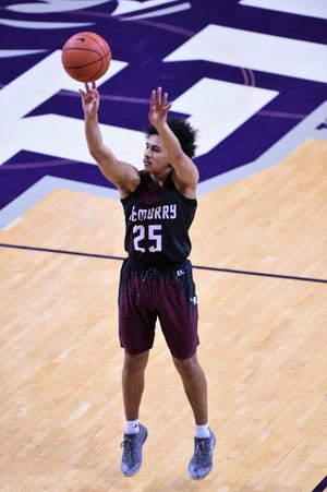 McMurry's Isaac Moreno (25) takes a 3-point shot during Saturday's game against ACU at Moody Coliseum.