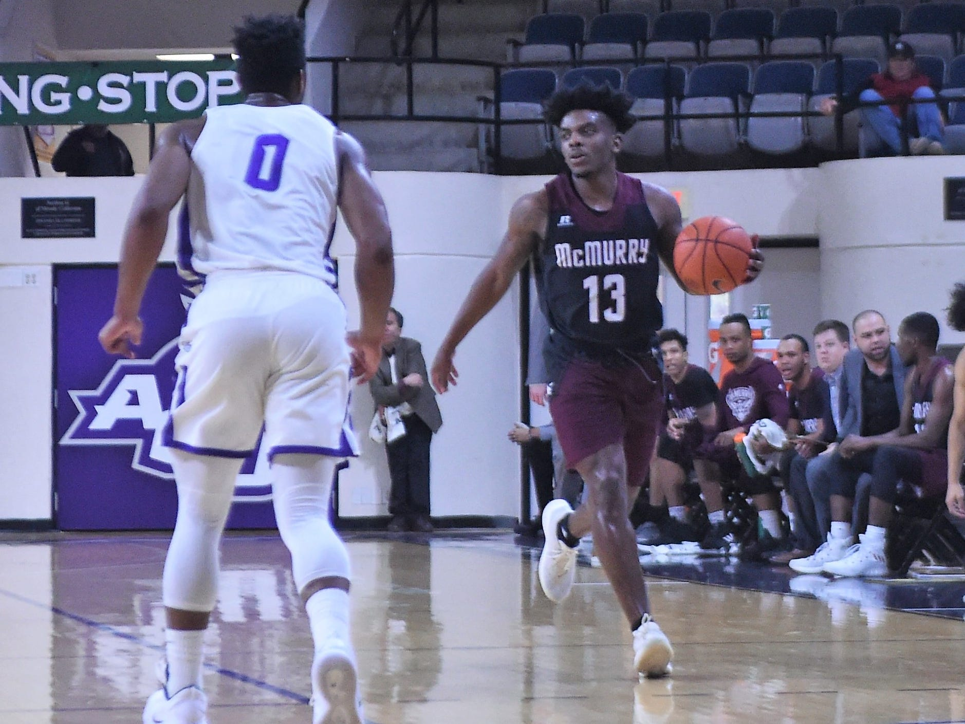 McMurry's Zacc Carter (13) brings the ball down the court during Saturday's game against ACU at Moody Coliseum.