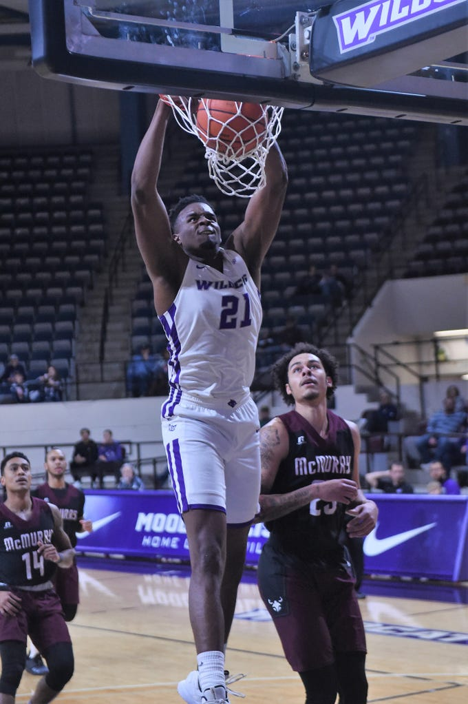 ACU's Jalone Friday (21) slams home a dunk during Saturday's game aginst McMurry at Moody Coliseum.