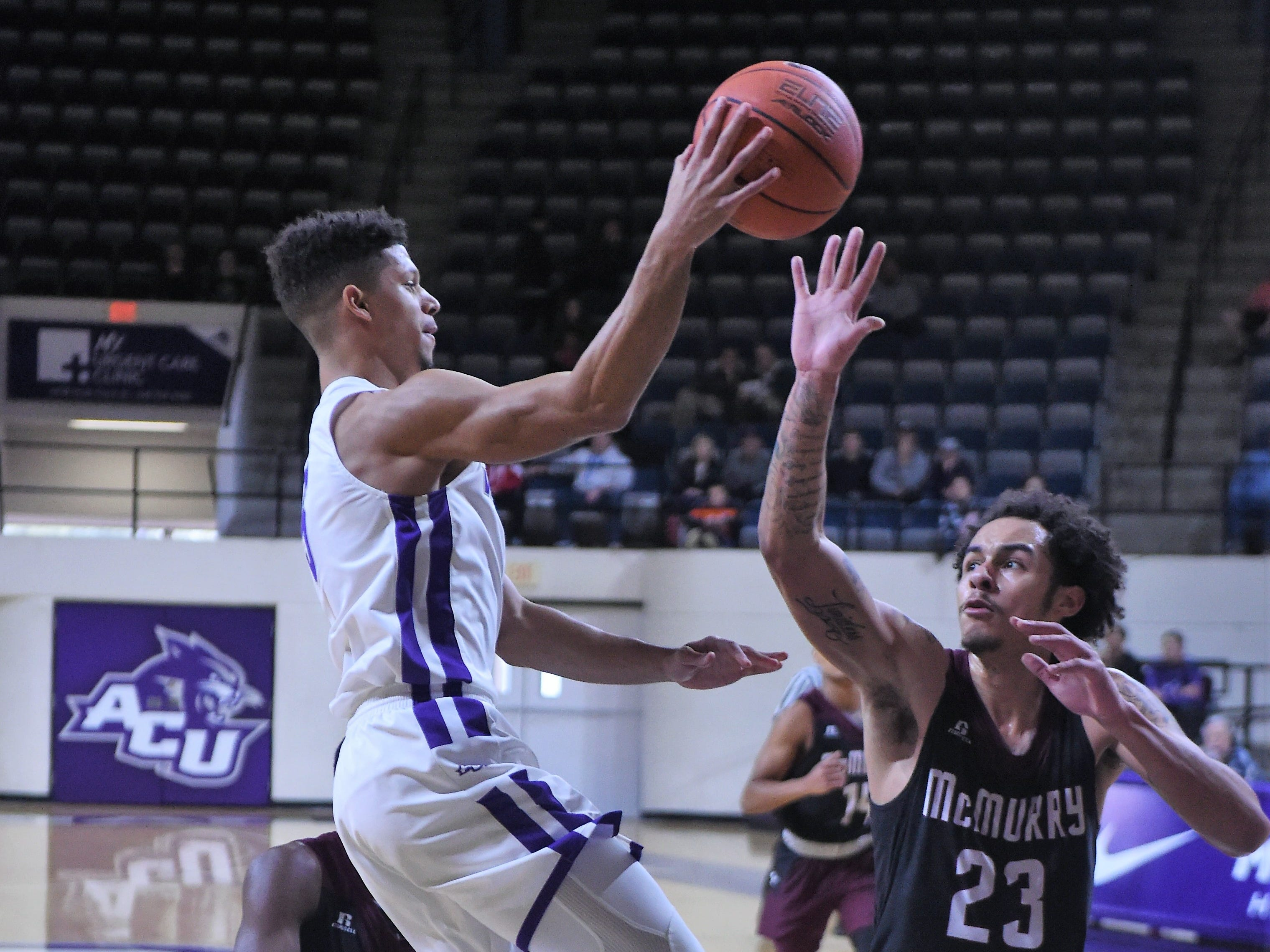 ACU's Payten Ricks (5) passes out of a double-team during Saturday's game against McMurry at Moody Coliseum.