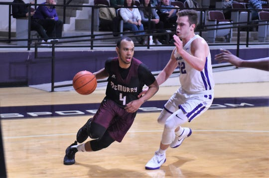 McMurry's Colin Taylor (4) tries to drive past ACU's Chase Cobb (22).