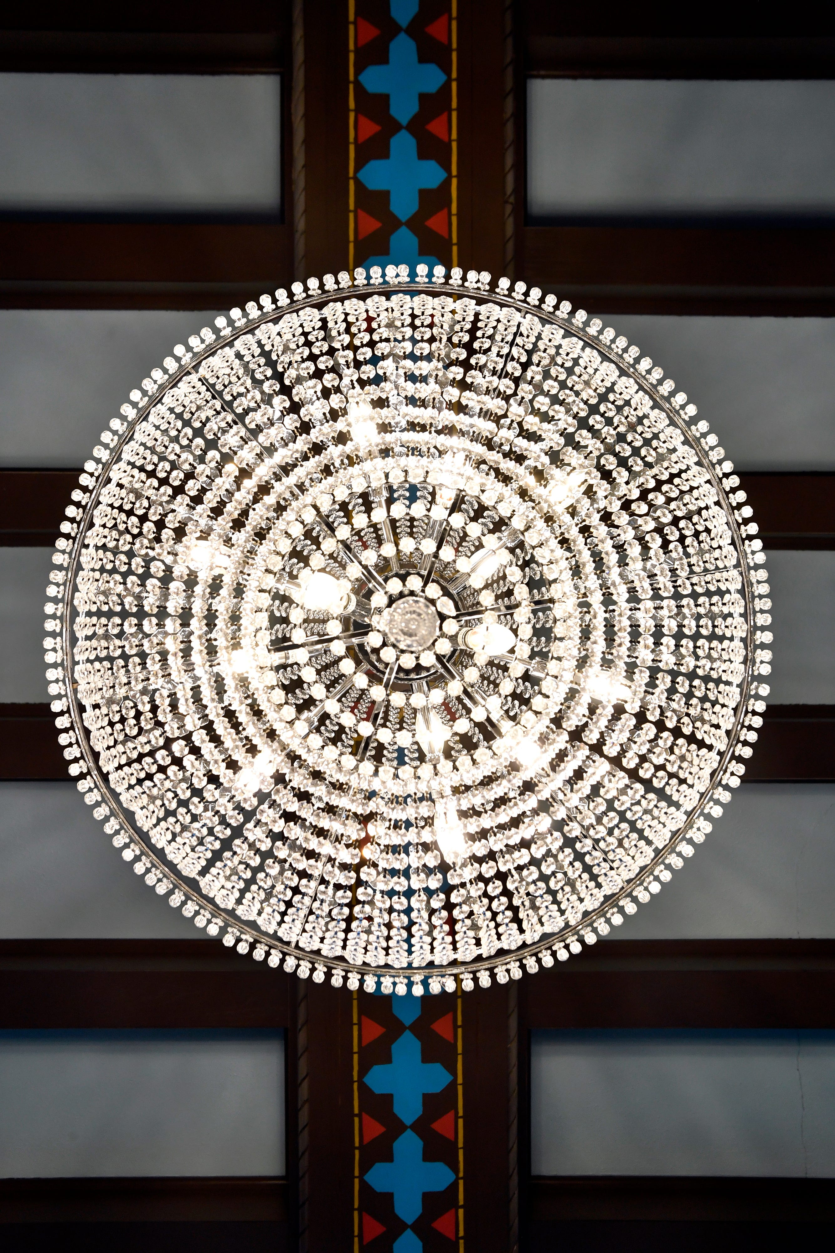 A chandelier hangs from the ceiling in the lobby of the Laguna Hotel Lofts in Cisco.
