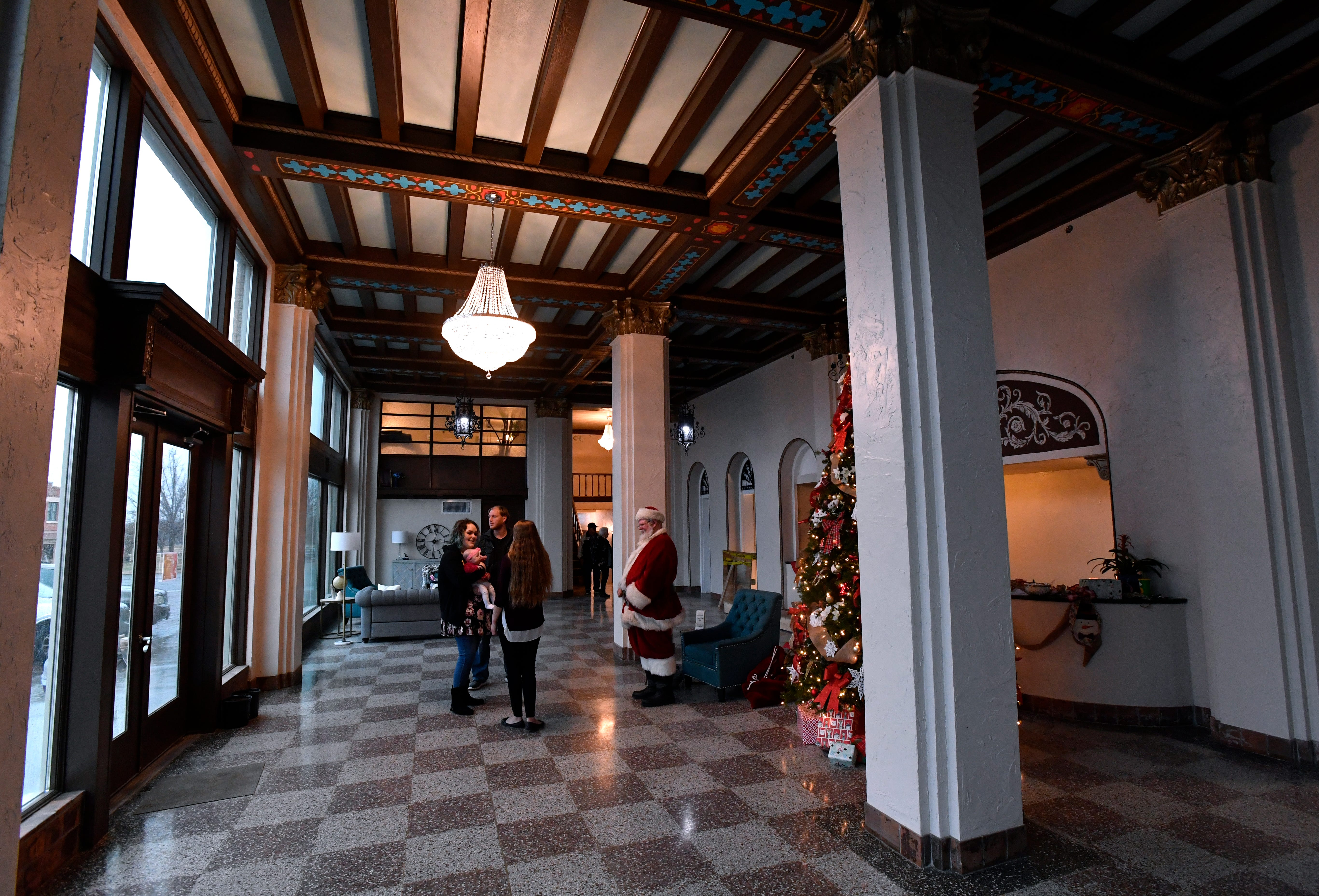 Visitors enter the lobby of the Laguna Hotel Lofts in Cisco Dec. 7, 2018 during an open house. The eight-story, 1929 building has been completely renovated into affordable housing.