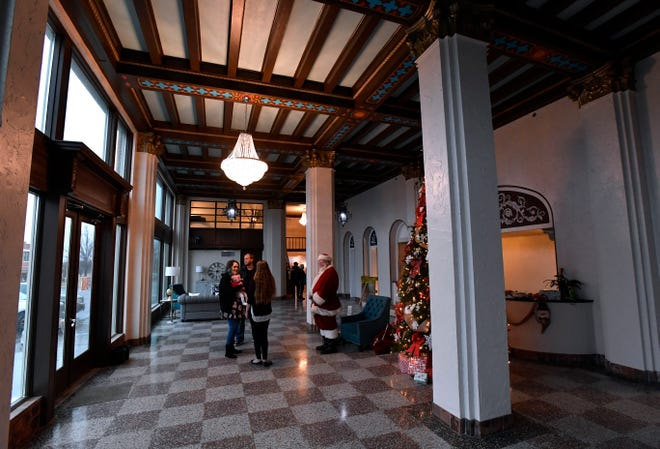 Visitors enter the lobby of the Laguna Hotel Lofts in Cisco on Dec. 7 during an open house. The eight-story, 1929 building has been completely renovated into affordable housing.