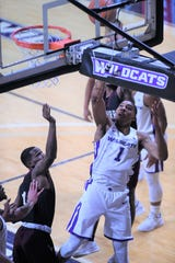 ACU's Jaren Lewis (1) lays the ball in during Saturday's game against McMurry at Moody Coliseum.