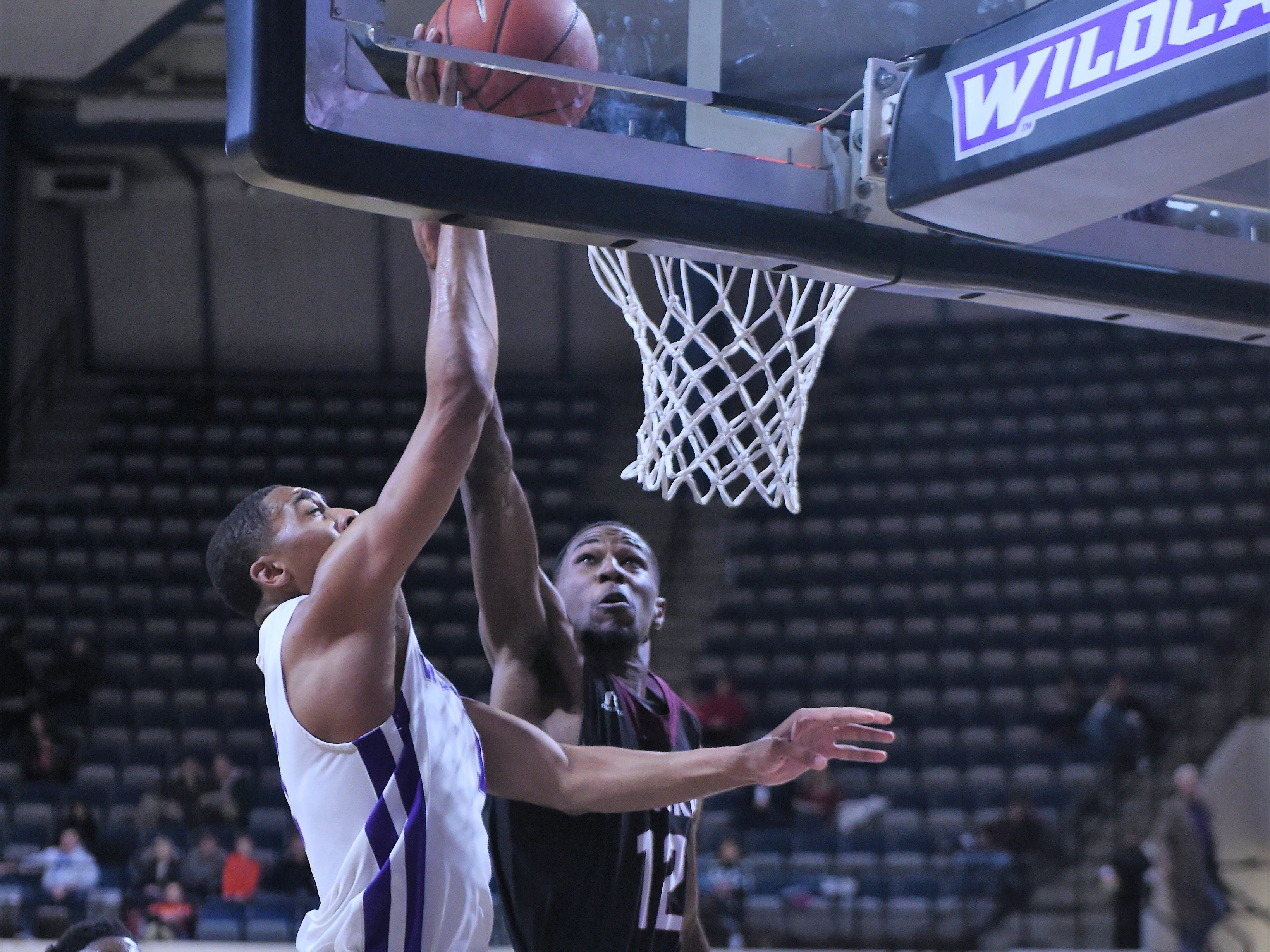 McMurry's Khalil Butler (12) blocks an ACU shot attempt during Saturday's game at Moody Coliseum.
