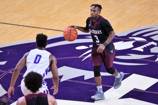 McMurry's Dedrick Berry (3) brings the ball past midcourt during Saturday's game against ACU at Moody Coliseum.