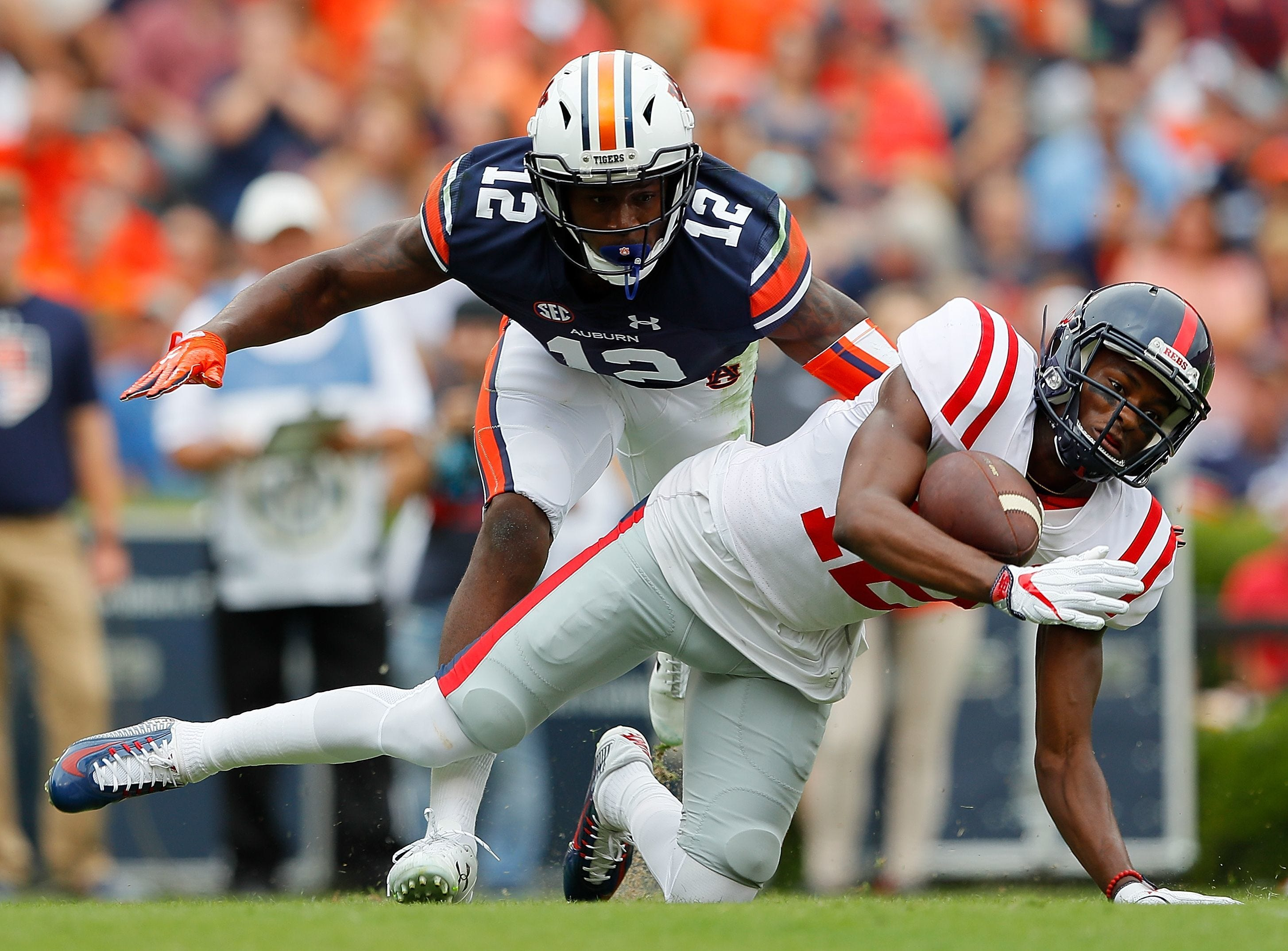 Cocoa grad Jamel Dean (12) of the Auburn Tigers defends a pass attempt to Ole Miss' Van Jefferson at Jordan Hare Stadium on October 7, 2017. (Photo by Kevin C. Cox/Getty Images)  Kevin C. Cox, Getty Images Cocoa grad Jamel Dean (12) of the Auburn Tigers defends a pass attempt to Ole Miss' Van Jefferson at Jordan Hare Stadium on October 7, 2017. (Photo by Kevin C. Cox/Getty Images)
