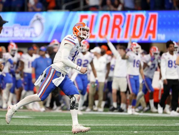 Dec 29, 2018; Atlanta, GA, USA; Florida Gators quarterback Feleipe Franks (13) celebrates a touchdown by running back Lamical Perine (not pictured) in the fourth quarter against the Michigan Wolverines in the 2018 Peach Bowl at Mercedes-Benz Stadium. Mandatory Credit: Jason Getz-USA TODAY Sports