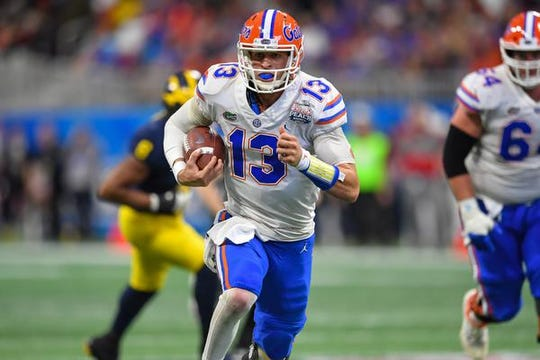 Dec 29, 2018; Atlanta, GA, USA; Florida Gators quarterback Feleipe Franks (13) runs for a touchdown against the Michigan Wolverines during the first half in the 2018 Peach Bowl at Mercedes-Benz Stadium. Mandatory Credit: Dale Zanine-USA TODAY Sports