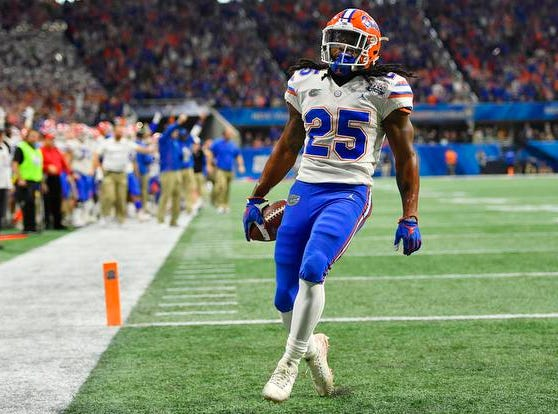 Florida running back Jordan Scarlett (25) runs into the end zone for a touchdown against Michigan during the first half of the Peach Bowl NCAA college football game, Saturday, Dec. 29, 2018, in Atlanta. (AP Photo/Mike Stewart)