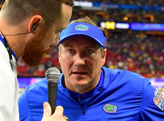 ATLANTA, GEORGIA - DECEMBER 29:  Head coach Dan Mullen of the Florida Gators is interviewed after the first half during the game against the Michigan Wolverines during the Chick-fil-A Peach Bowl at Mercedes-Benz Stadium on December 29, 2018 in Atlanta, Georgia. (Photo by Scott Cunningham/Getty Images)