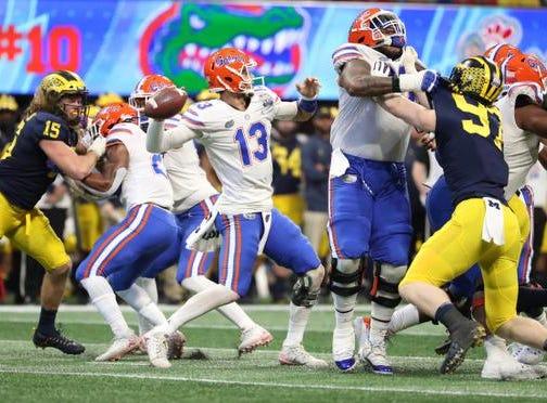 Dec 29, 2018; Atlanta, GA, USA; Florida Gators quarterback Feleipe Franks (13) attempts a pass in the first quarter against the Michigan Wolverines in the 2018 Peach Bowl at Mercedes-Benz Stadium. Mandatory Credit: Jason Getz-USA TODAY Sports