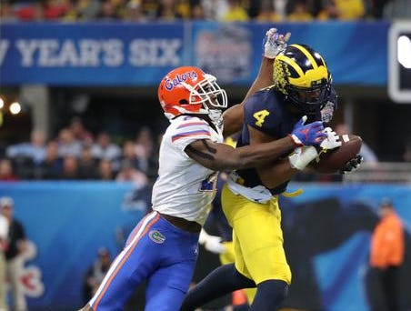 Dec 29, 2018; Atlanta, GA, USA; Michigan Wolverines wide receiver Nico Collins (4) makes a catch against Florida Gators defensive back Trey Dean III (21) in the first quarter in the 2018 Peach Bowl at Mercedes-Benz Stadium. Mandatory Credit: Jason Getz-USA TODAY Sports