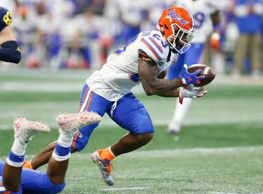 ATLANTA, GEORGIA - DECEMBER 29:  Chauncey Gardner-Johnson #23 of the Florida Gators returns an interception for a touchdown in the fourth quarter against the Michigan Wolverines during the Chick-fil-A Peach Bowl at Mercedes-Benz Stadium on December 29, 2018 in Atlanta, Georgia. (Photo by Mike Zarrilli/Getty Images)