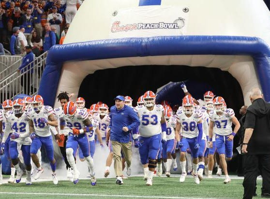 Dec 29, 2018; Atlanta, GA, USA; Florida Gators head coach Dan Mullen runs out with the team before their game against the Michigan Wolverines in the 2018 Peach Bowl at Mercedes-Benz Stadium. Mandatory Credit: Jason Getz-USA TODAY Sports