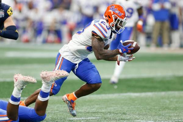 Chauncey Gardner-Johnson  of the Florida Gators returns an interception for a touchdown in the fourth quarter against the Michigan Wolverines during the Chick-fil-A Peach Bowl at Mercedes-Benz Stadium on December 29, 2018 in Atlanta, Georgia. (Photo by Mike Zarrilli/Getty Images)