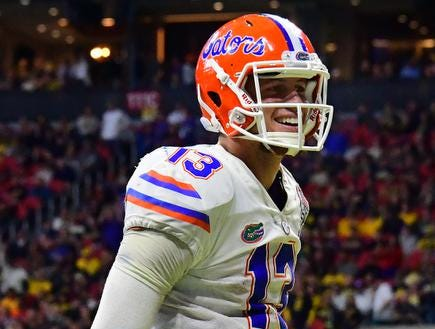 ATLANTA, GEORGIA - DECEMBER 29:  Feleipe Franks #13 of the Florida Gators celebrates a third quarter touchdown by teammate Jordan Scarlett (not pictured) against the Michigan Wolverines during the Chick-fil-A Peach Bowl at Mercedes-Benz Stadium on December 29, 2018 in Atlanta, Georgia. (Photo by Scott Cunningham/Getty Images)