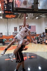 Junior Tanner Smallwood jumps over a player from Eastern to try and score for Waverly Friday night during the first night of the Pike County Holiday Classic at Waverly High School. Eastern defeated Waverly 47-41.