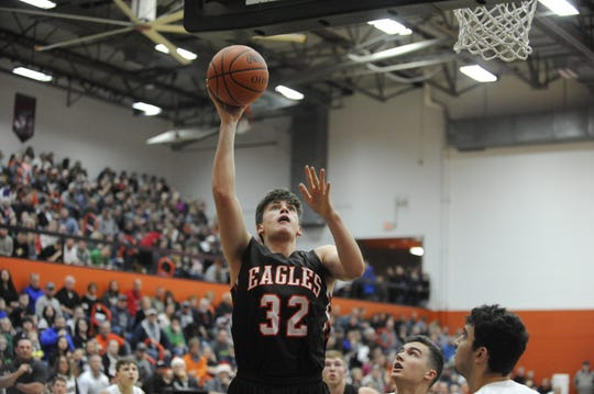 The Eagles' big man Michael Miller scored his 1,000th career point in a 76-45 win over Minford on Tuesday as he helped his team win its 18th straight game of the season.