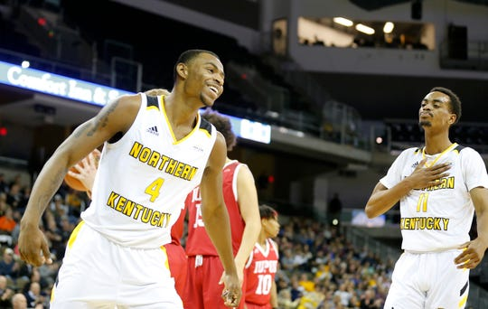 Norse forward Adrian Nelson (4) and guard Jalen Tate celebrate in the final minutes. NKU won 92-77.