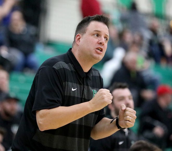 Harrison head coach Andy Marx reacts during the Wildcats' basketball game against Taylor Friday, Dec. 28, 2018.