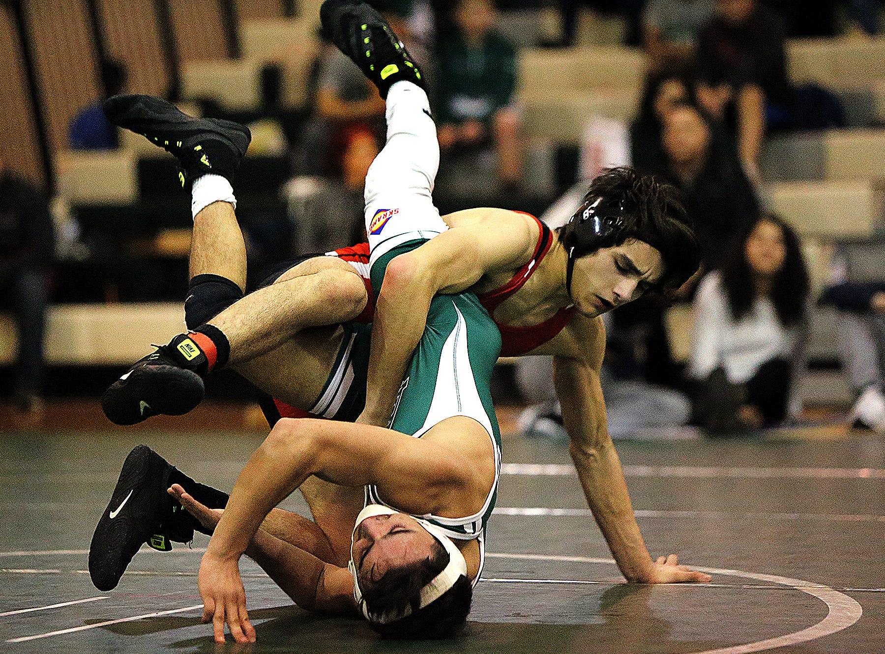 Bear Invitational wrestling tournament. 132lb Alexander Martinez (Bound Brook) top over Louis LaRocca (East Brunswick)