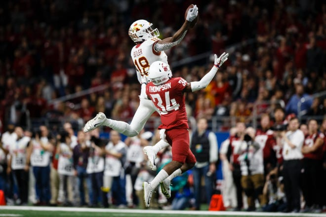 Iowa State's Hakeem Butler (18) makes a one-handed catch over Washington State's Jalen Thompson (34) during the Valero Alamo Bowl on Friday, Dec. 28, 2018, in San Antonio. Washington State would go on to win 28-26.
