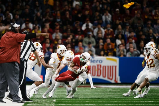 Washington State's Jamire Calvin (6) is tackled by Iowa State's Mike Rose (23) during the Valero Alamo Bowl on Friday, Dec. 28, 2018, in San Antonio. Washington State takes a 21-10 lead over Iowa State into halftime.