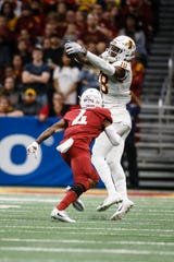 Iowa State's Hakeem Butler (18) makes a catch during the Valero Alamo Bowl on Saturday, Dec. 29, 2018, in San Antonio. Washington State would go on to win 28-26.