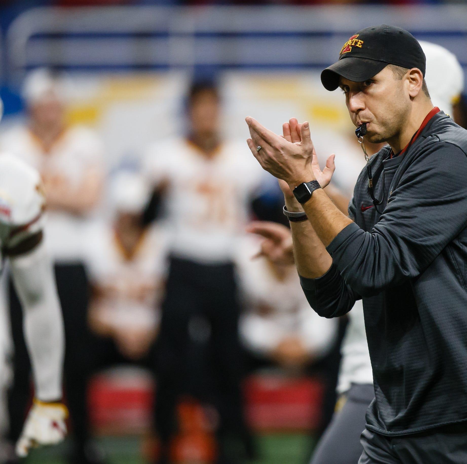 Iowa State head coach Matt Campbell claps during...