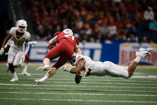 Iowa State's Marcel Spears Jr. (42) tackles Washington State's Max Borghi (21) during the Valero Alamo Bowl on Friday, Dec. 28, 2018, in San Antonio. Washington State takes a 21-10 lead over Iowa State into halftime.
