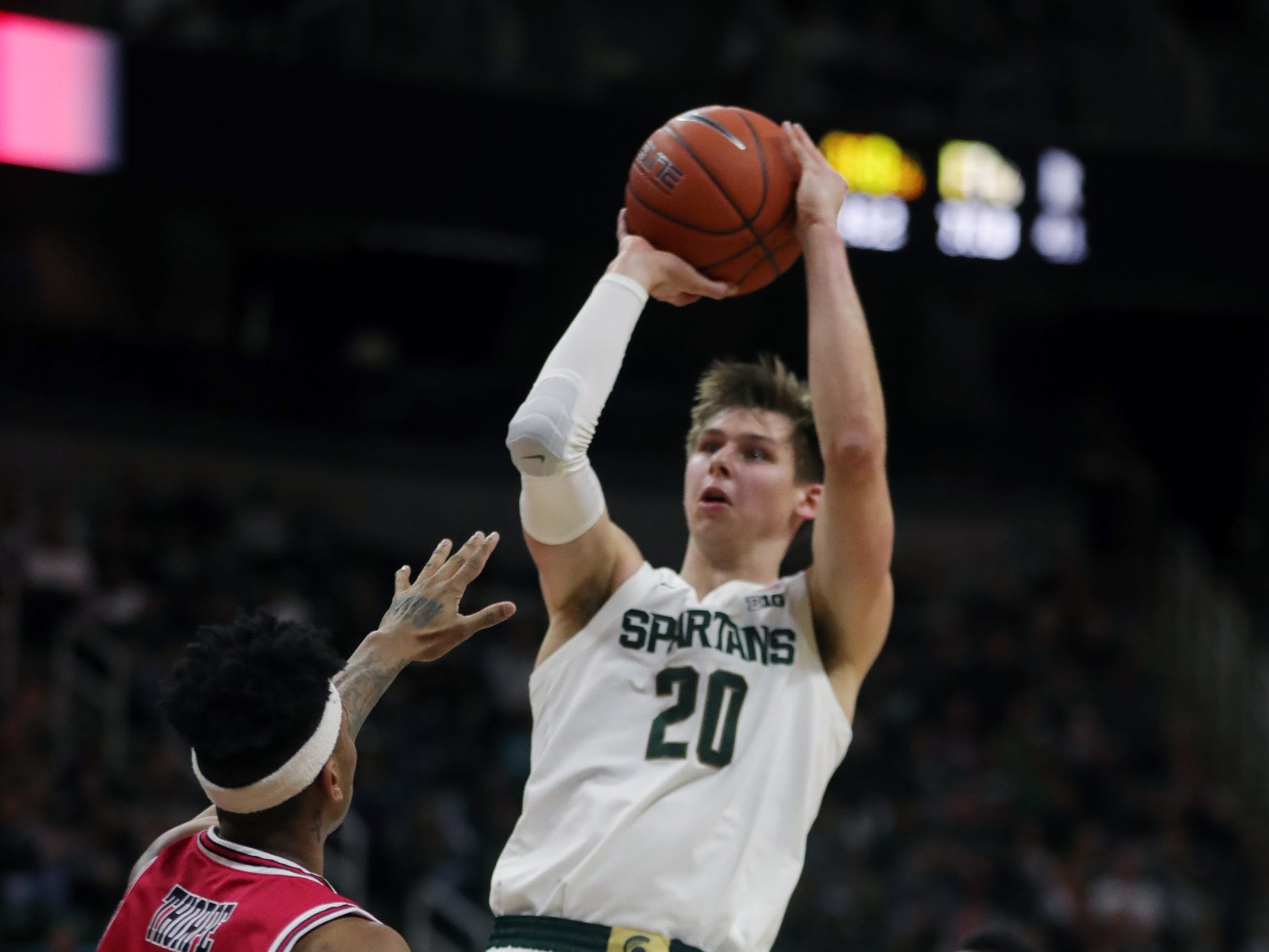 Michigan State guard Matt McQuaid scores against Northern Illinois guard Dante Thorpe during the second half Saturday, Dec. 29, 2018 at the Breslin Center in East Lansing.