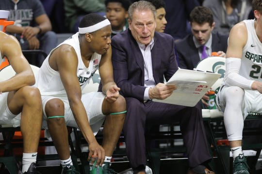Michigan State head coach Tom Izzo talks with Cassius Winston against Northern Illinois in the second half Saturday, Dec. 29, 2018 at the Breslin Center in East Lansing.