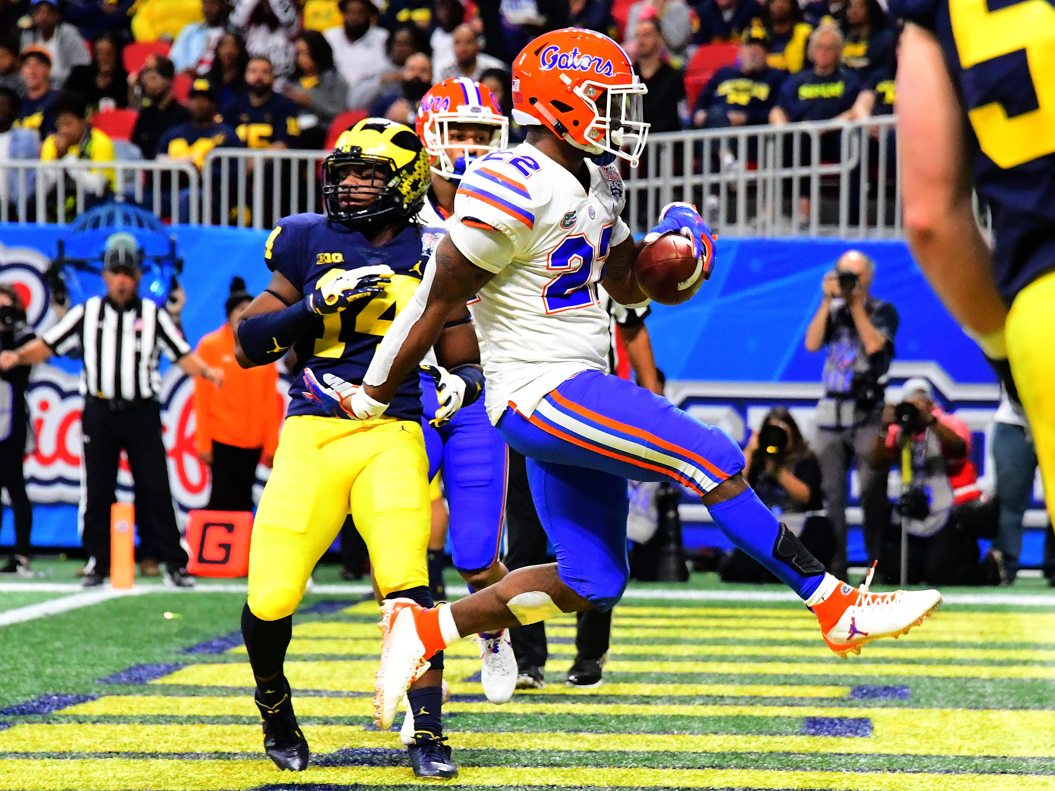 Florida running back Lamical Perine scores a third-quarter touchdown against Michigan during the Peach Bowl on Saturday, Dec. 29, 2018, in Atlanta.