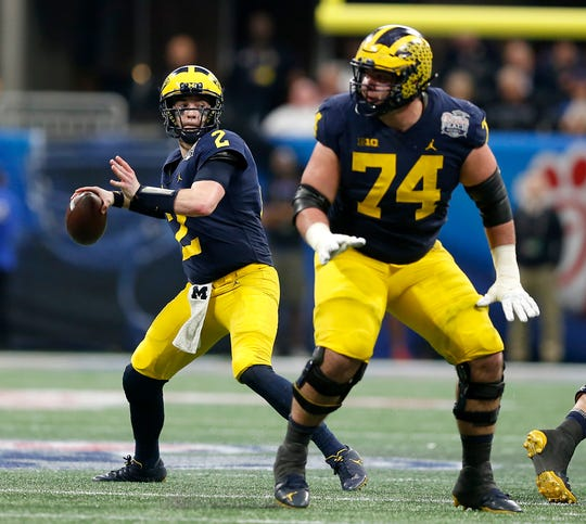Michigan quarterback Shea Patterson looks pass against Florida in the second quarter during the Peach Bowl on Saturday, Dec. 29, 2018, in Atlanta.
