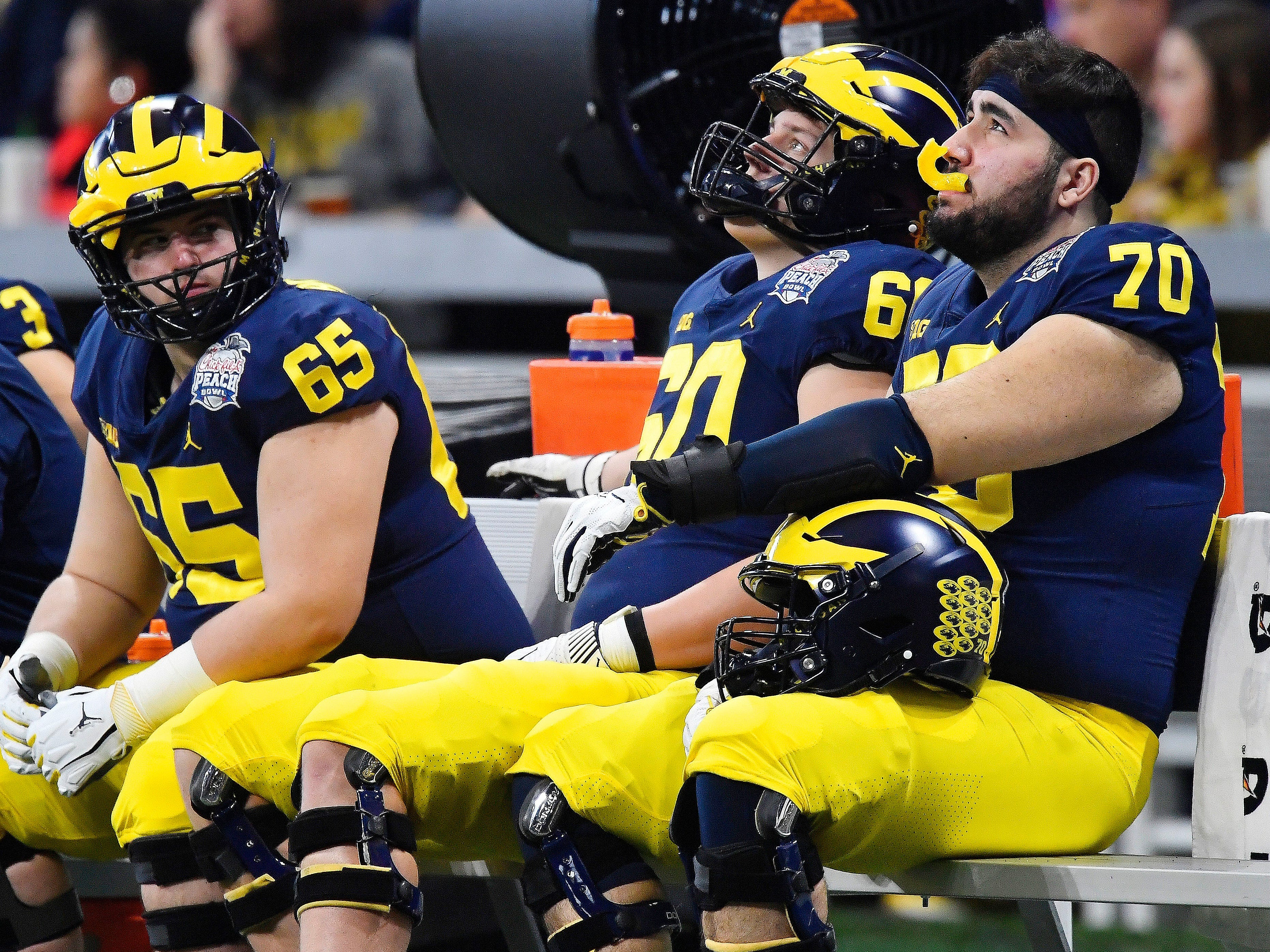 Michigan players sit on the bench in the closing seconds of the Peach Bowl NCAA college football game against Florida, Saturday, Dec. 29, 2018, in Atlanta. Florida won 41-15.
