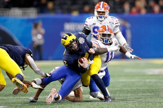 Michigan QB Shea Patterson runs the ball in the third quarter against Florida during the first half on Saturday, Dec. 29, 2018, in Atlanta.