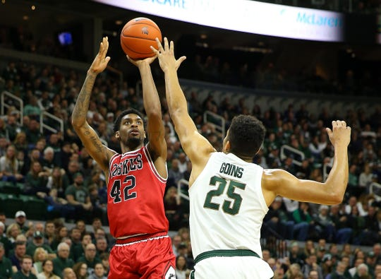 Northern Illinois forward Levi Bradley is defended by Michigan State forward Kenny Goins during the first half on Saturday, Dec. 29, 2018, in East Lansing.