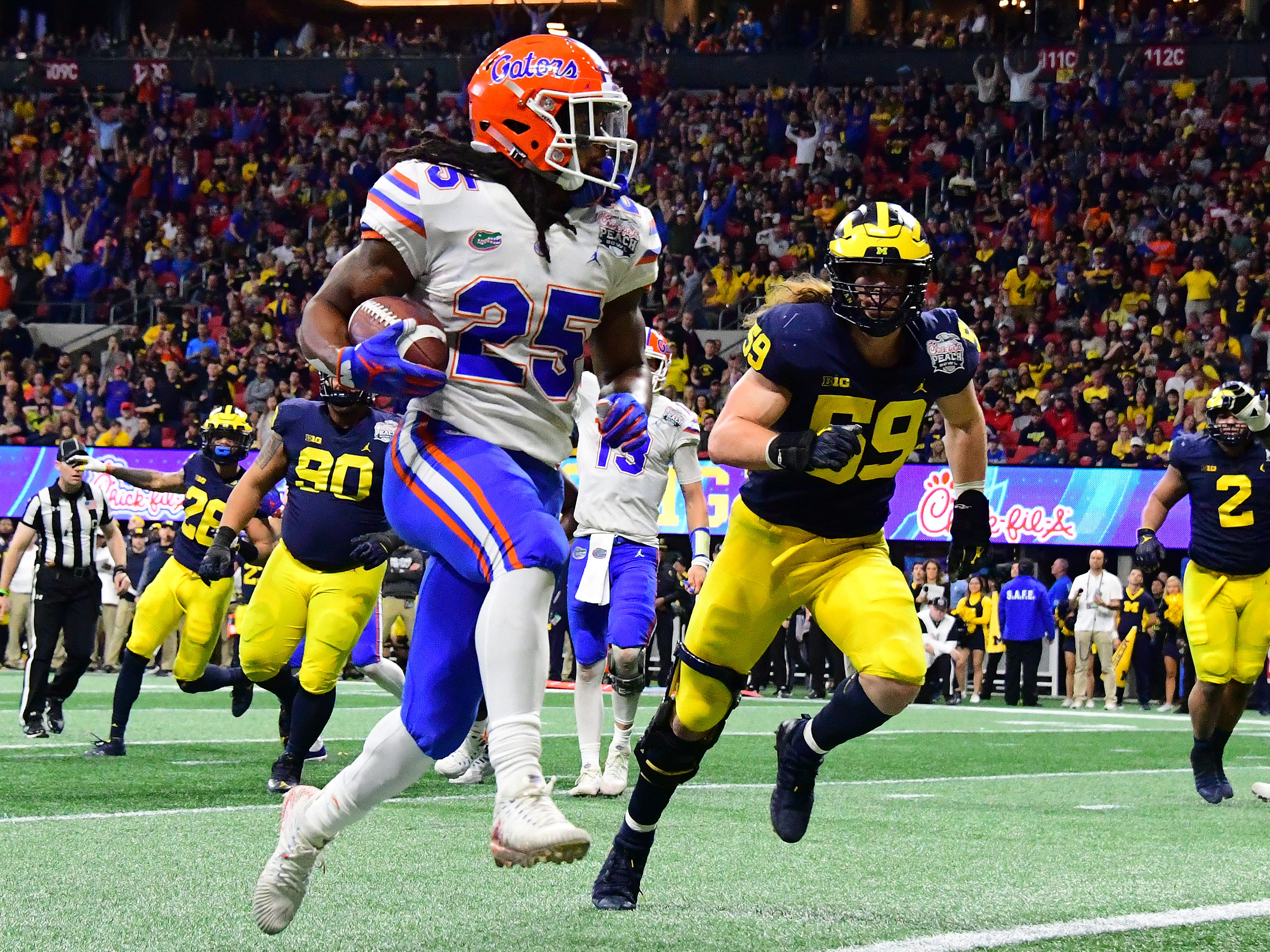 Florida running back Jordan Scarlett scores a third-quarter rushing touchdown against Michigan during the Peach Bowl on Saturday, Dec. 29, 2018, in Atlanta.