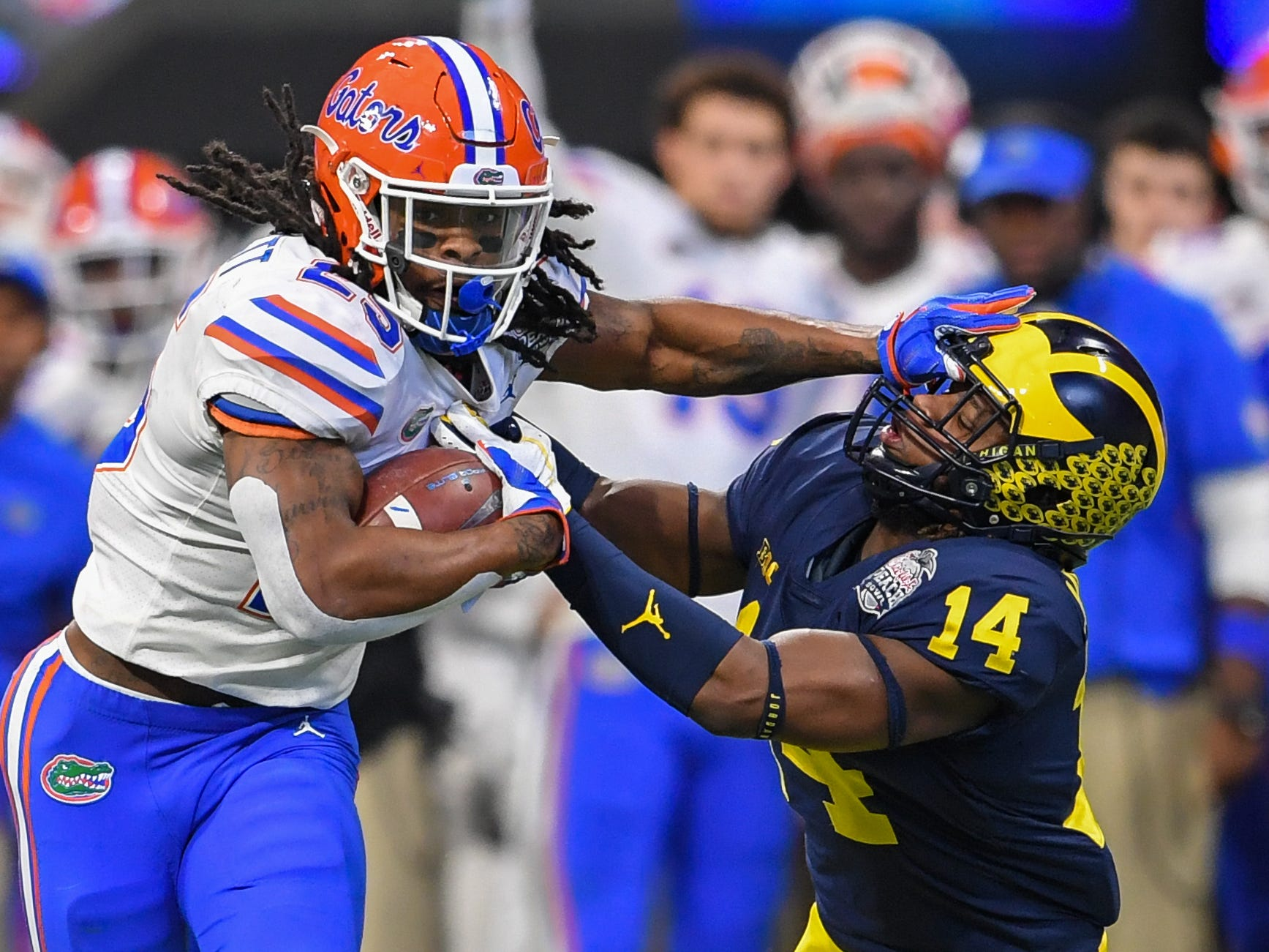 Florida running back Jordan Scarlett runs against Michigan defensive back Josh Metellus during the Peach Bowl on Saturday, Dec. 29, 2018, in Atlanta.