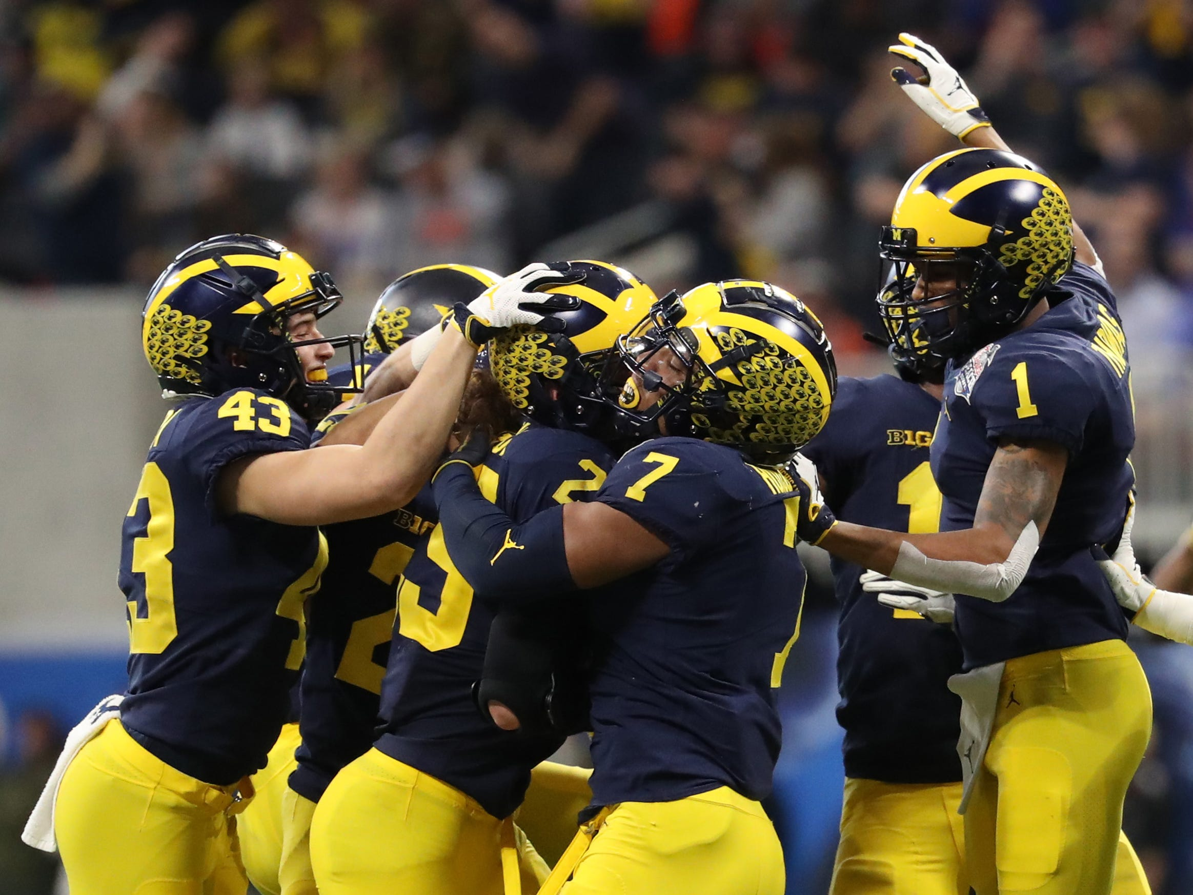 Michigan celebrate after linebacker Jordan Glasgow (29) recovers a blocked punt by Florida punter Tommy Townsend (not pictured) in the second quarter during the Peach Bowl on Saturday, Dec. 29, 2018, in Atlanta.