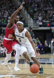 Michigan State guard Cassius Winston drives against Northern Illinois guard Eugene German during the second half Saturday, Dec. 29, 2018 at the Breslin Center in East Lansing.