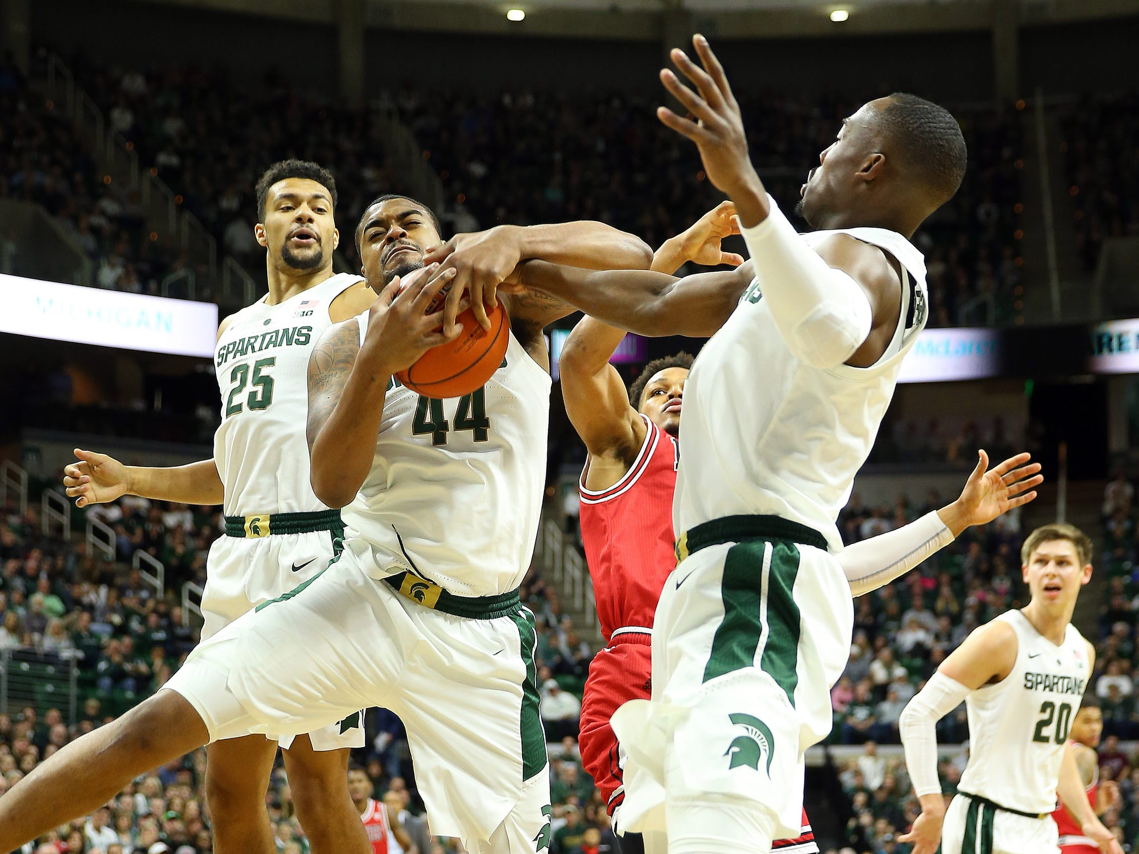 Michigan State forward Nick Ward, center, and guard Joshua Langford fight for a loose ball during the first half on Saturday, Dec. 29, 2018, in East Lansing.