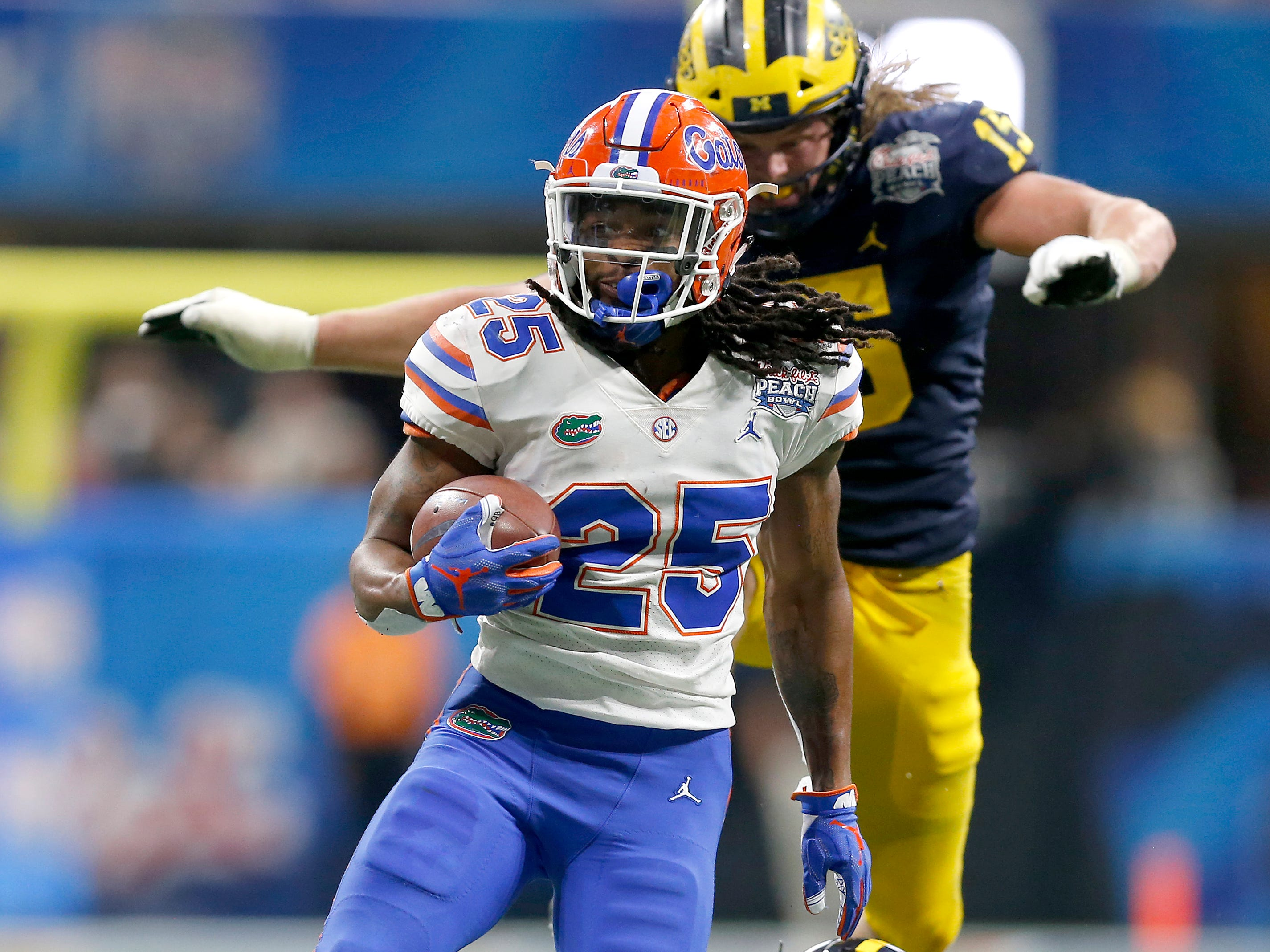 Florida running back Jordan Scarlett scores a third-quarter rushing touchdown during U-M's 41-15 loss in the Peach Bowl on Saturday, Dec. 29, 2018, in Atlanta.