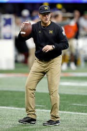 Michigan coach Jim Harbaugh looks on during warm ups before the Peach Bowl against Florida on Saturday, Dec. 29, 2018, in Atlanta.