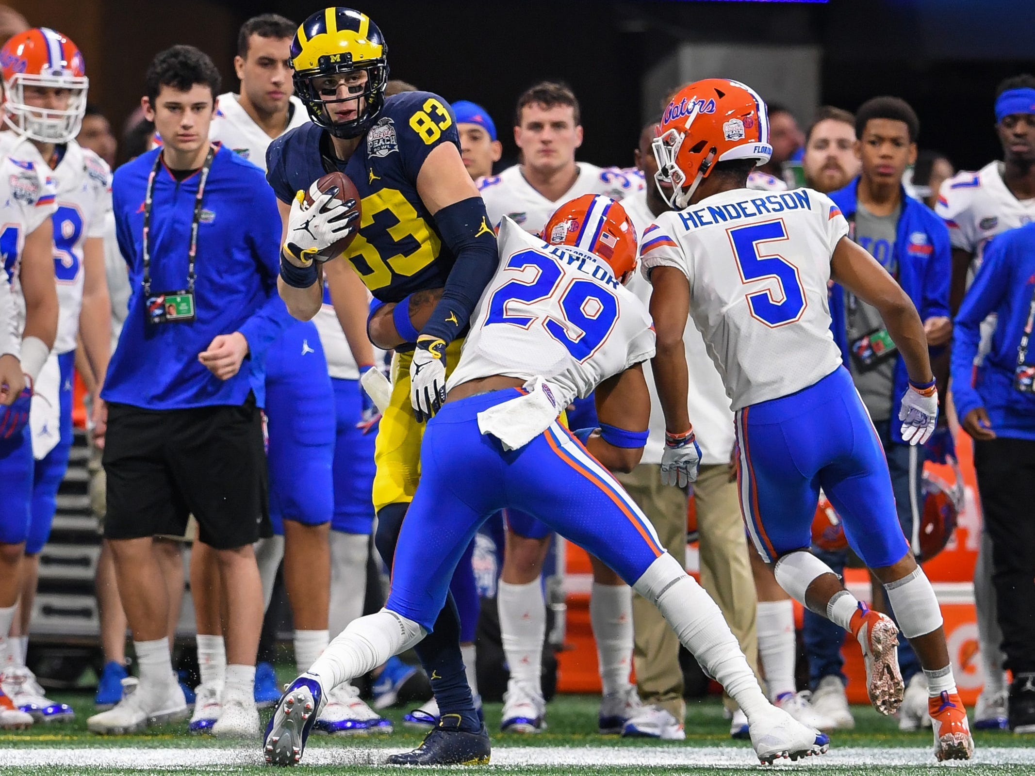 Michigan tight end Zach Gentry runs against Florida defensive back Jeawon Taylor in the first quarter of the Peach Bowl on Saturday, Dec. 29, 2018, in Atlanta.