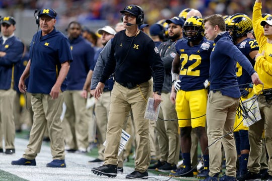 Michigan coach Jim Harbaugh looks on in the first quarter during the Peach Bowl on Saturday, Dec. 29, 2018 in Atlanta.