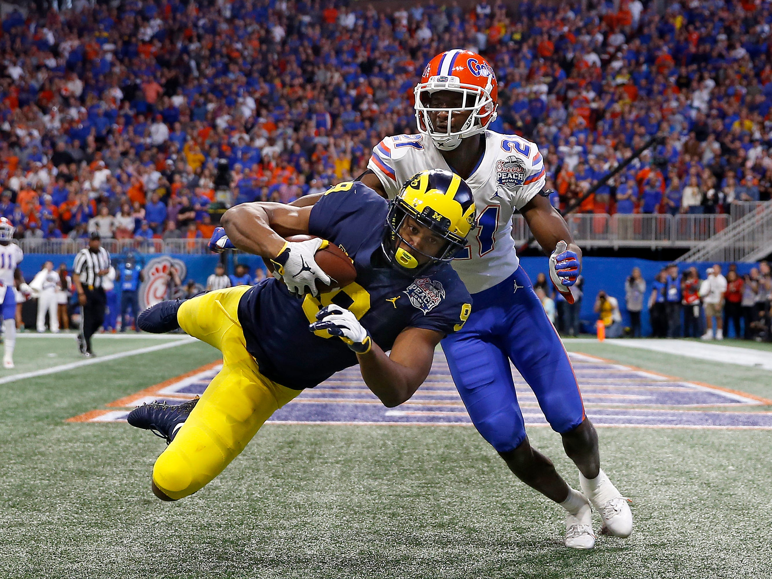 Michigan wide receiver Donovan Peoples-Jones scores a touchdown reception against Florida's Trey Dean III during the Peach Bowl on Saturday, Dec. 29, 2018, in Atlanta.