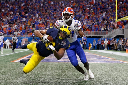 Michigan wide receiver Donovan Peoples-Jones scores a touchdown reception against Florida's Trey Dean III during the Peach Bowl on Saturday, Dec. 29, 2018, in Atlanta.
